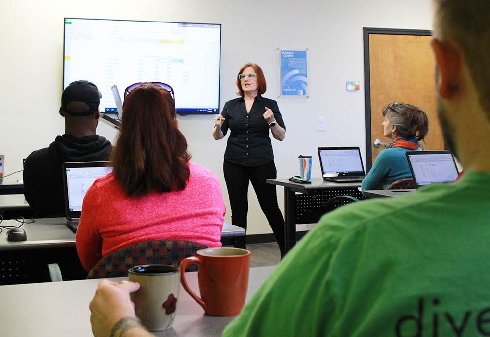 Woman Teaching Tech