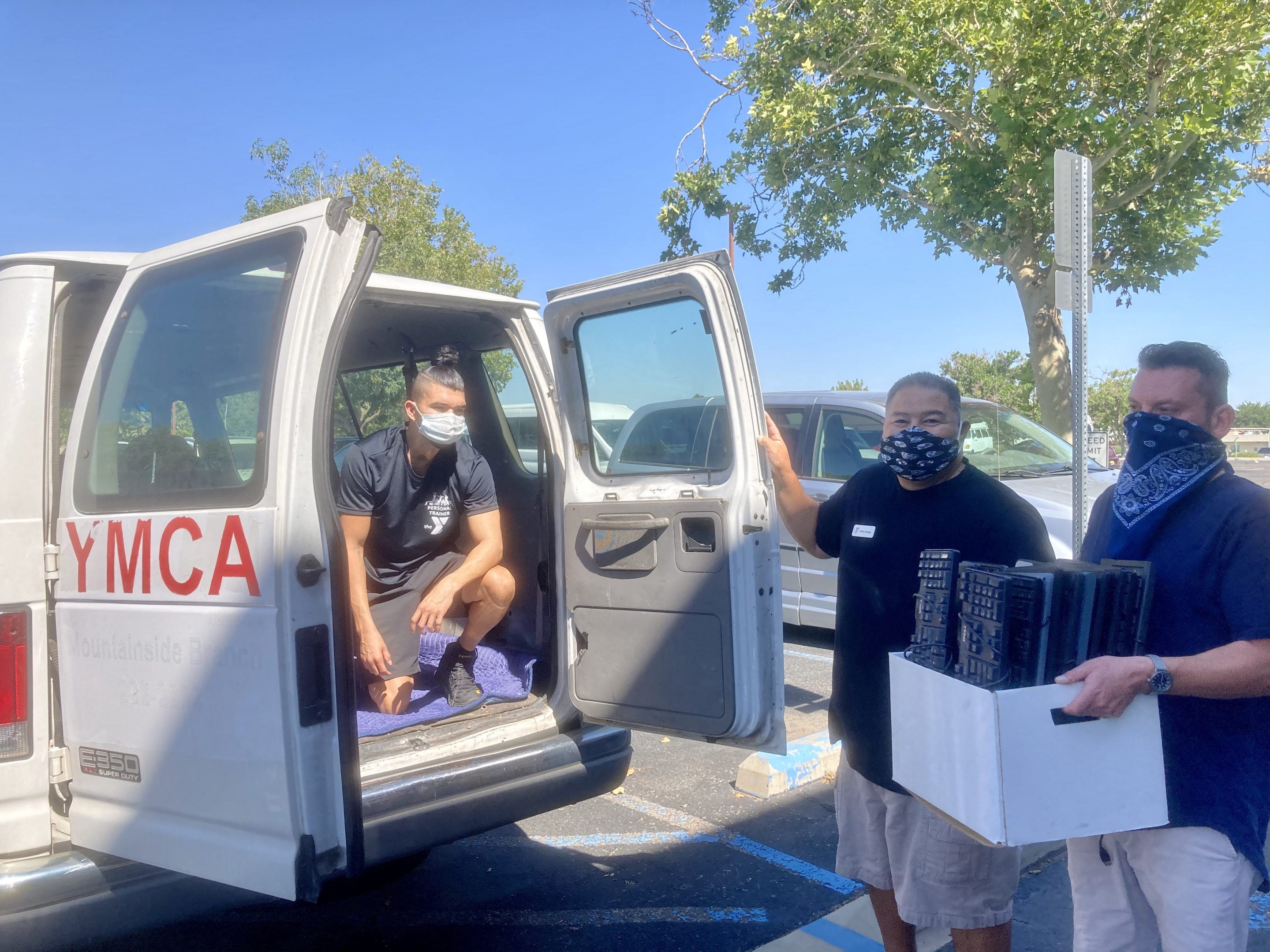 staff-from-DiverseIT-and-YMCA-NewMexico-load-donated-computers-into-a-van