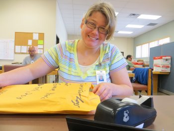 Photo of associate at Adelante Document Imaging with an orange folder