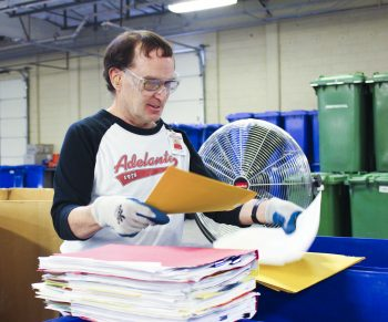 James P. sorting paper at DDS