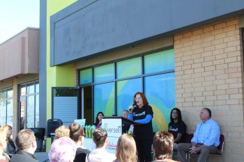 Meta Hirschl, VP of Information Systems, talks to a crowd gathered at the DiverseIT location, announcing the grand opening