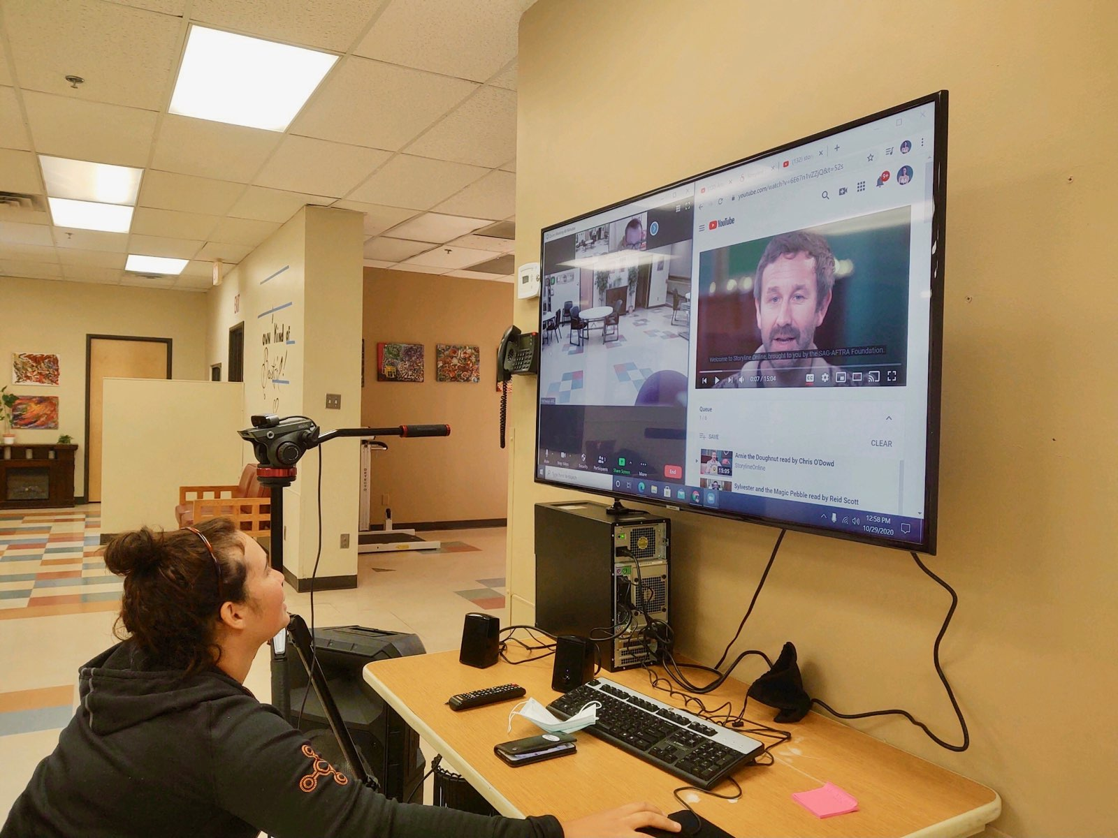 Yumi, and Adelante staff member, plays a YouTube video for day services clients as part of virtual learning.
