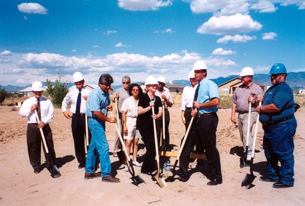Mike Kivitz with board members, donors, and a construction at a ground breaking in Belen in the 1990s.