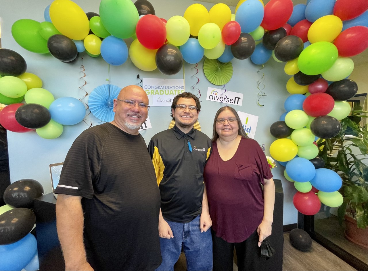 Josh and his parents celebrate his graduation from DiverseIT