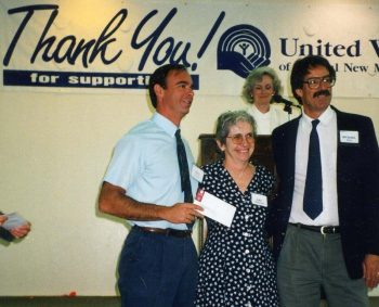Mike Kivitz, former CEO of Adelante, accepts a check from United Way early in his career.